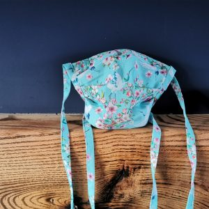 Turquoise floral cotton face mask handmade by ooh betty clothing